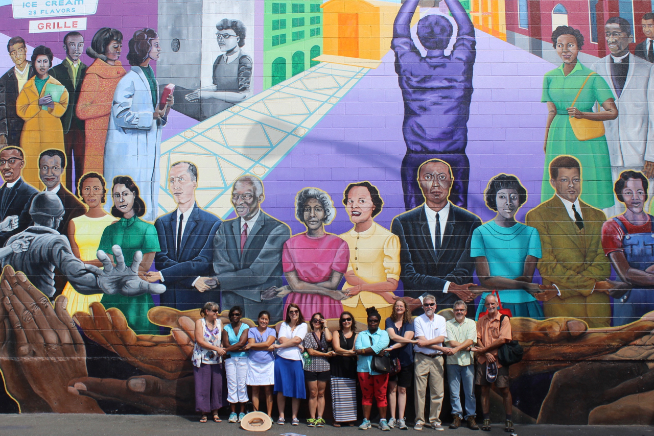 A group of students in front of a martin luther king mural